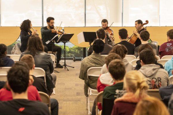 Flutist Mais Hriesh, Violinist Shaden Nahara, violist Amichai Yaakov Hefter, and cellist Eli Levi perform at Kehillah Jewish High School in Palo Alto on Thursday, November 15. Photo by Karla Chouhan.