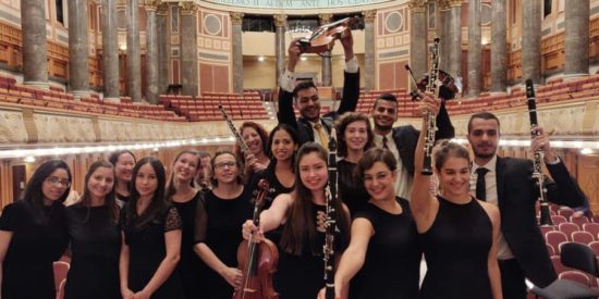 Members of the orchestra celebrating after the final performance in Wiesbaden.